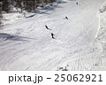 Skiers and snowboarders on ski slope at winter day 25062921