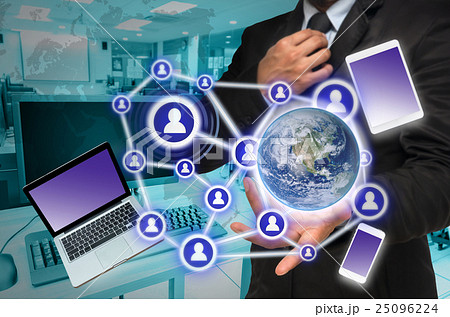 Businessman with show hand posture with the Social media and technology devide on computer room background, Elements of this image furnished by NASA, Business network concept 25096224