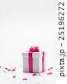 White gift box with pink ribbon and plum petal 25196272