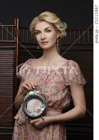 Beautiful girl with vintage clock 25215887