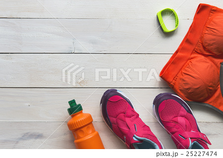 Sport shoes and clothes on wooden backgroundの写真素材 [25227474] - PIXTA