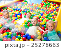 children playing together in pool with plastic multicolored balls 25278663