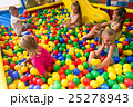 kids playing with multicolored plastic balls . 25278943
