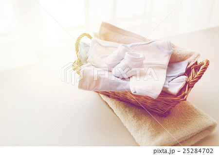 close up of baby clothes for newborn boy in basketの写真素材 [25284702] - PIXTA