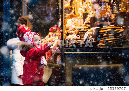 Kids look at candy and pastry on Christmas market 25379707
