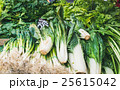 Various fresh green vegetables and herbs on market 25615042