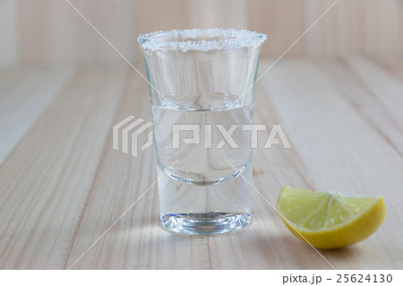 Vodka shot and salt sea, lemon  on wooden tableの写真素材 [25624130] - PIXTA