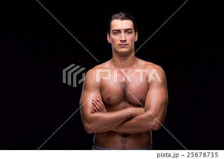Ripped muscular man on black background 25678735
