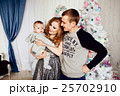 Christmas tree and happy family around 25702910