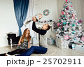 Christmas tree and happy family around 25702911