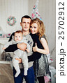 Christmas tree and happy family around 25702912
