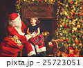 happy child girl hugging Santa 25723051