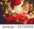 happy child girl hugging Santa and holding gift 25723058