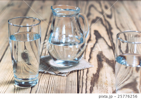 Decanter and glasses with water on wooden tableの写真素材 [25776256] - PIXTA