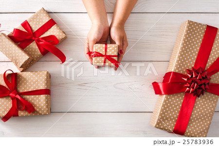 Womans hands give christmas gift in present box 25783936 womans hands give christmas gift in present box negle Images
