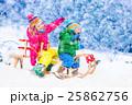 Kids having fun on sleigh ride 25862756