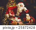 sad upset santa claus talking on phone 25872428