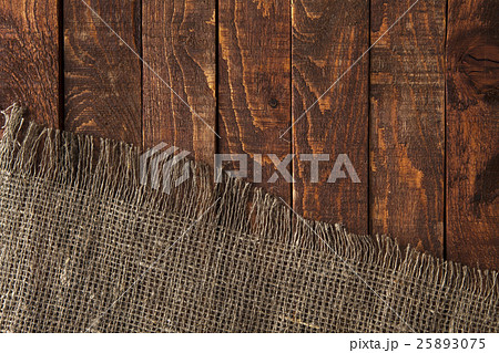 Dark wood with old burlap cloth, top view 25893075