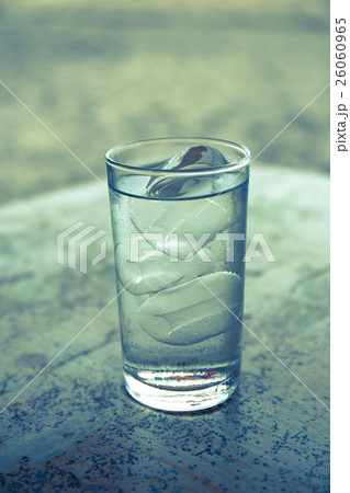 Glass of ice water on the tableの写真素材 [26060965] - PIXTA