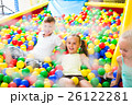 kids playing with multicolored plastic balls . 26122281