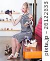 Young girl shopaholic holding desired shoe 26122633