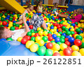 Group of kids playing on playground with plastic balls 26122851