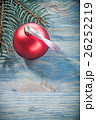 Composition of pine branch red bauble on wooden 26252219