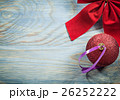 Composition of red Christmas bow ball on wooden 26252222