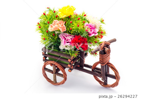 Artificial flowers with wooden tricycle toyの写真素材 [26294227] - PIXTA