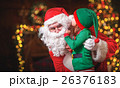 happy cheerful child elf helper and Santa Claus at Christmas 26376183