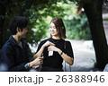 神社を散策するカップル おみくじ 26388946
