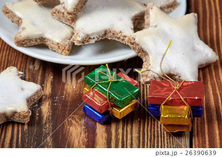 Christmas cookies and parcels on wooden tableの写真素材 [26390639] - PIXTA