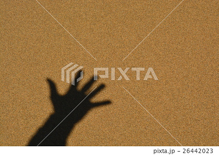 Five fingers hand shadow on Sand Background 26442023