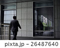 businessman walking toward a glass window 26487640