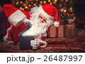 Santa Claus with magical glowing Christmas present 26487997