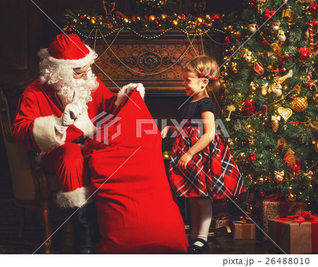 Santa claus presents christmas gift happy child 26488010 santa claus presents christmas gift happy child negle Gallery