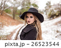 Portrait of a young beautiful woman in black hat 26523544