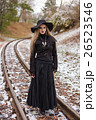 Woman walking on railway tracks 26523546