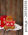 Christmas gingerbread men on wooden background 26534556