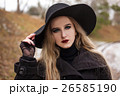 Portrait of a young beautiful woman in black hat 26585190