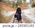 Woman walking on railway tracks 26585193