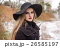 Portrait of a young beautiful woman in black hat 26585197