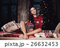 Christmas Woman in Winter Jumper Holding Xmas Gift 26632453