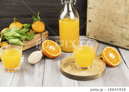 Tangerine juice in glass and fresh fruitの写真素材 [26645958] - PIXTA