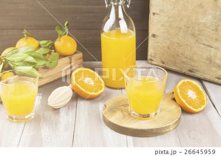 Tangerine juice in glass and fresh fruitの写真素材 [26645959] - PIXTA