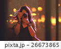 woman with camera on night city background 26673865