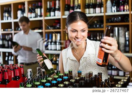 female customer in wine store. 26727407