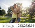 Woman and man dancing salsa in summer park 26823684