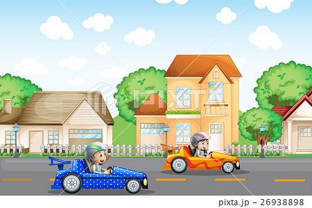 Two kids in racing car driving in neighborhood 26938898