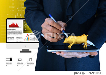 Man hand showing the stock market bull 26940810